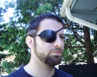 Pirate leather eye patch, you choose your color. Made of thick leather.