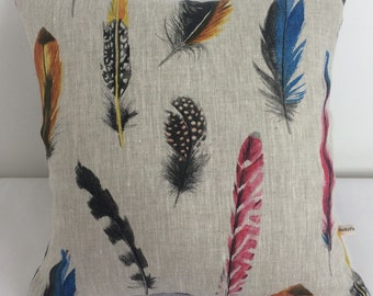 Multi feather print square cushion cover made from linen fabric.