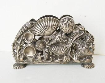1994 silver godinger, napkin holder, sea bottom, table decoration, silver table service, seashell art,