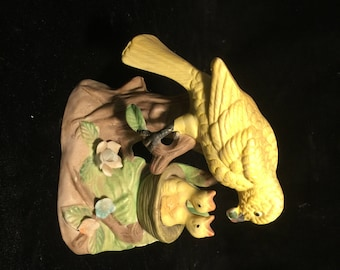Antique Yellow Bird Statue