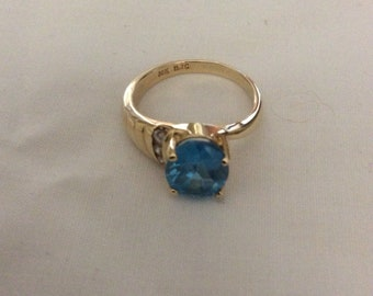 Blue topaz 14 k ring