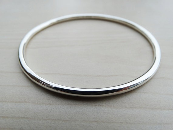 prejudice pride quote oval bangle silver product and darcy bangles austen buy romantic jane