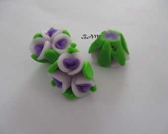 Punched flowers purple 15mm