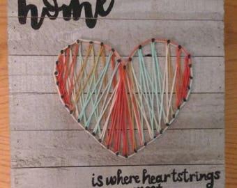 Home is where heartstrings meet wall art. String art