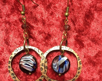 Dangle hammered hoop earrings with purple striped beads. Free shipping!