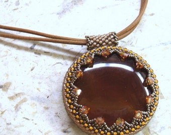 Tan leather necklace with woven bead embroidered carnelian pendant