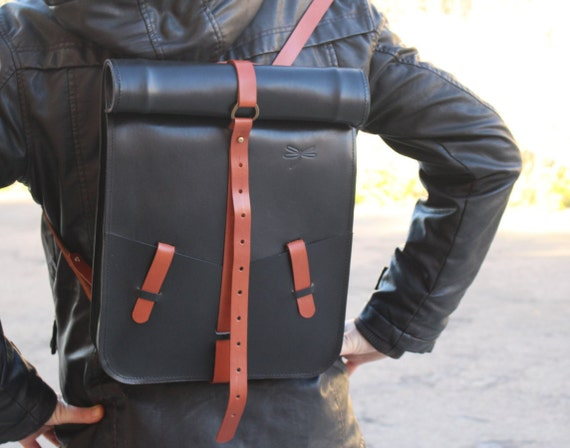 Roll-top Leather backpack for men and women. Black and brown leather. Designed and handmade by Ludena.