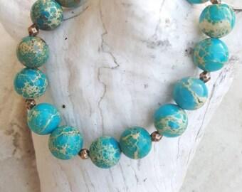 Sea sediment jasper and red copper stretch bracelet