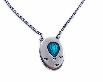 Hot air balloon  pendant, in silver with turquoise resin.