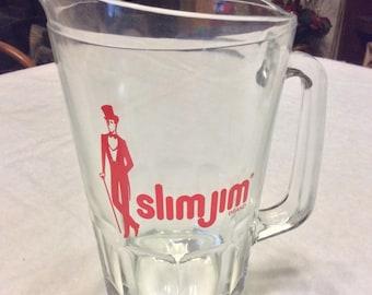 Vintage 1960's Slim Jim beer pitcher.
