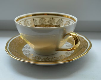 Old Vintage Austrian decorative gilded tea or coffee cup with matching saucer from A. J. Willner Klagenfurt Carinthia