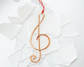 Treble clef hammered copper ornament