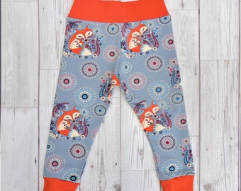 12-18 month baby toddler trousers. Organic cotton soft jersey cuffs. Mama Fox on grey with bright orange.