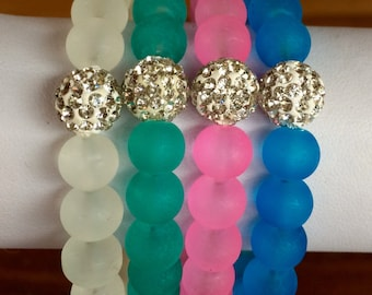 Choice of color: Frosted glass beaded bracelet with center polymer clay rhinestone pave bead