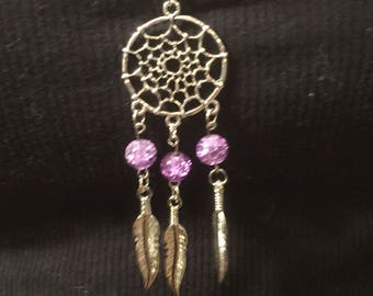 Dreamcatcher with purple glass beads and feathers