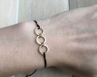 Minimalist adjustable bracelet, black with three gold colored circles
