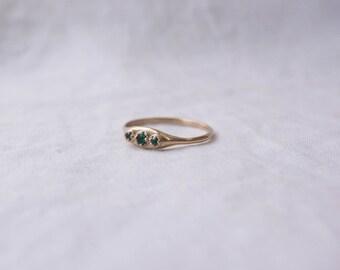 14k prong set triple emerald ring