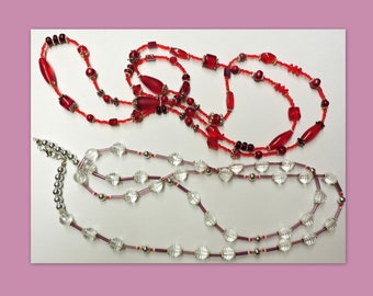 FREE SHIPPING - 2 Long HandCrafted Necklaces  .. 1 red with silver accents .. 1 with clear beads and light purple accents