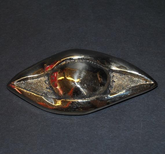 Decoration item, handmade.Oxydized brass eye.