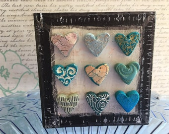 mixed media art with turquoise blue hearts- polymer clay hearts on art block