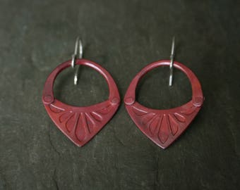 patinated red stamped copper petal earrings