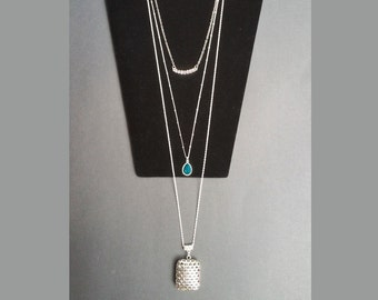 Handmade trendy long 3 tiered layered necklace with 3 different pendants on mismatching silver colored chains