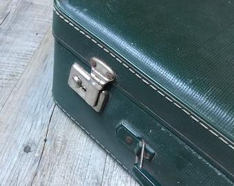 Vintage green suitcase