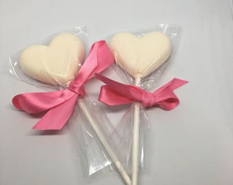 1 dozen White Candy heart pops with pink sprinkles