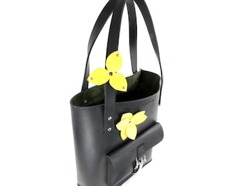 Black Italian leather tote with green suede lining and latch front pocket