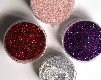 4 boxes of glitter purple shades