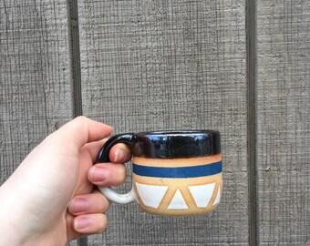 Stripes and triangles handmade ceramic mug. blue white and black.