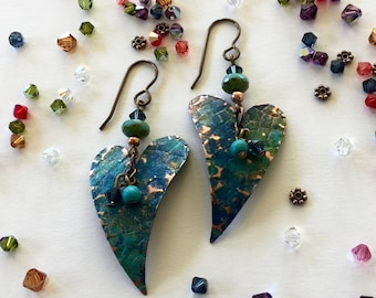 Earrings: Embossed hearts with blue, green patina + magnesite + blue swarovski crystals