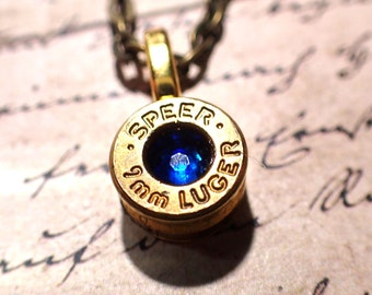 Up-Cycled  bullet casing necklace with crystal in center brass bullet shell jewelry 9mm casing
