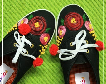 Flower themed hand embroidered shoes