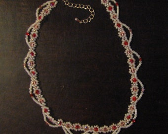 Delicate Swarovski crystal necklace.  Perfect for a young girl or as a choker.  Made with peach and red crystals.