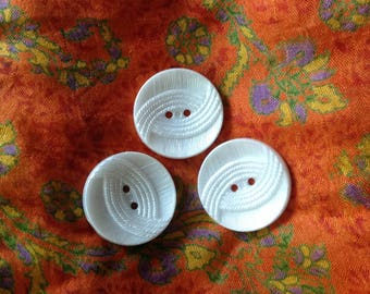 Set of three vintage buttons, white color.