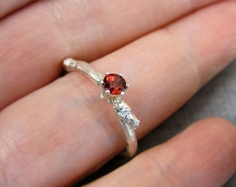 budding twig sterling silver ring with red diamond cut garnet. Contemporary engagement ring.