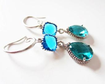 Framed glass earrings.  Teal green blue earrings.  Silver earrings.  Double dangles.