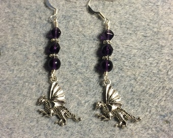 Silver dragon charm dangle earrings adorned with grape purple Czech glass beads.