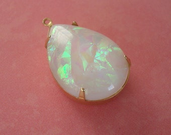 Vintage  Lucite White Opal Smooth Pear Shaped Stone Brass Prong Setting.