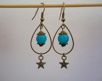 Bronze earrings with a blue glass bead and a star - Gypsy chic jewelry - Bohemian star