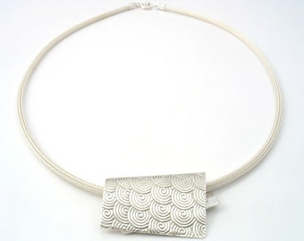 """Sterling silver spiral pattern on this """"distorted"""" rectangle.  Modern and stylist look, on mesh silver chain"""
