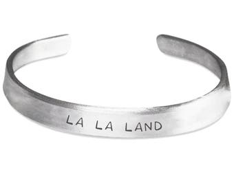 LALA LAND Bracelet - Stamped Metal Bangle - Musical Fan Gift Jewelry - One Size Fits All