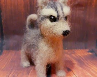 Felting dog. Hand work beautiful, fluffy dog. children can be very pleased.