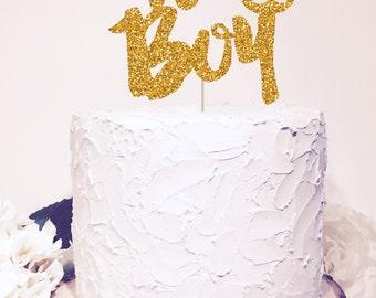 It's a Boy Cake Topper. Chic baby shower decor. Gold Glitter Sparkle. Cursive Script letter.