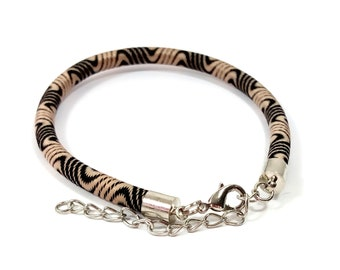1 bracelet made of rayon black and beige 21 cm