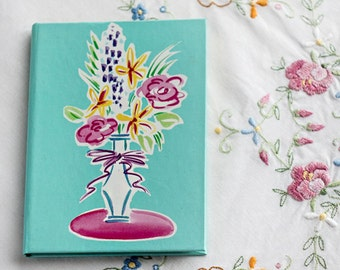 Sea blue address book_blue pink yellow_violet green white_ phone address book_floral illustration_vase with flowers_Russ Berrie and Company