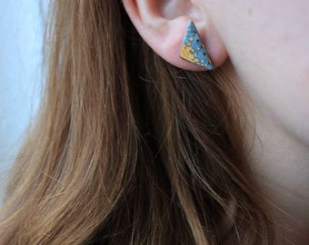 Small porcelain earrings in a shape of triangle covered with gold, silver stud