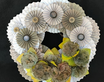 mauve and beige paper rosette wreath with special colored paper carnations