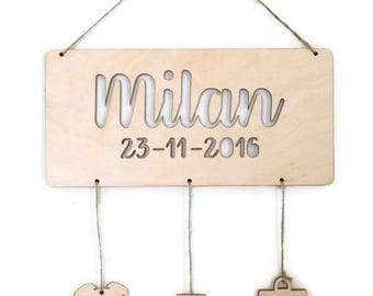 Name sign with wooden hangers